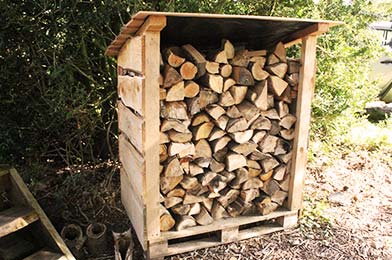 Wooden Logstore Built by Sussex Timber Co